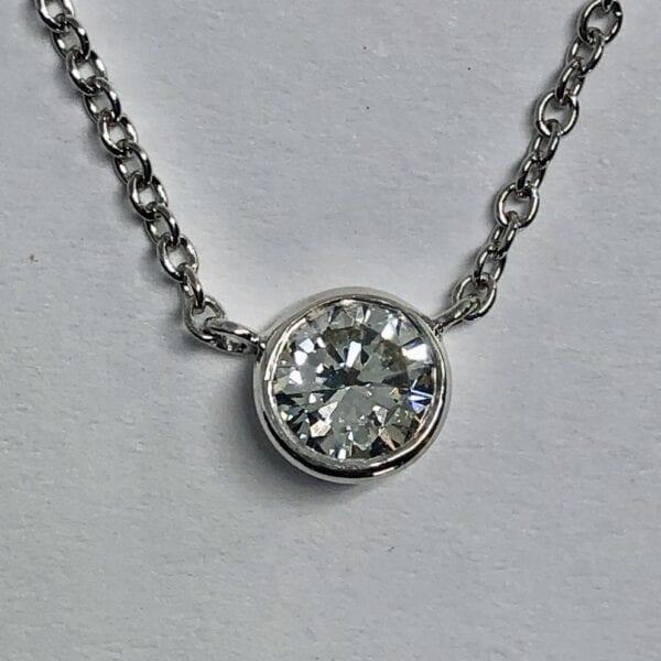 Diamond pendant on silver chain