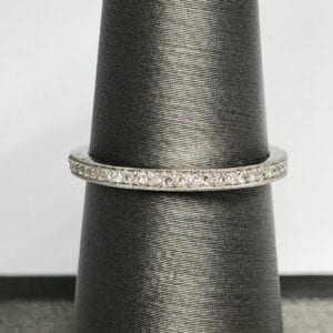 White gold ring with many smaller diamonds