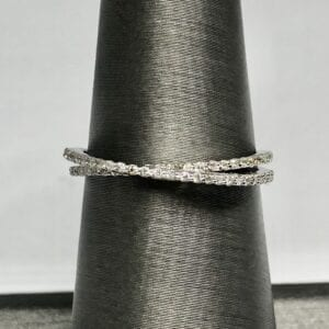 White gold diamond ring crossed band