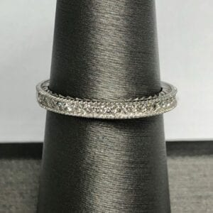 ring with small diamonds on ring stand