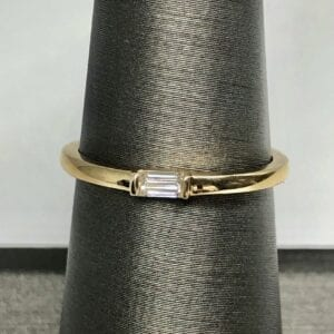 gold baguette ring on ring stand