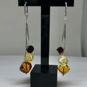 Closeup amber drop earrings tricolor