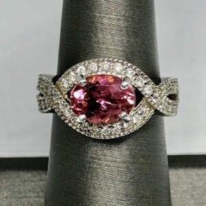 pink tourmaline gem around diamond ring