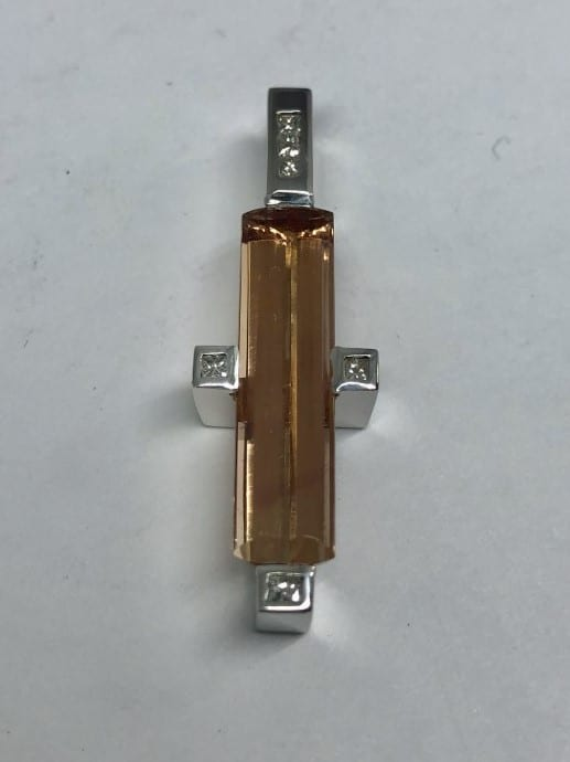 Gold bar jewelry with silver detailing